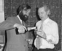 Bart Fossey helps Jack Howlett to a glass of his favourite tipple